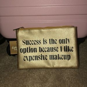 Because I like expensive makeup bag NWT
